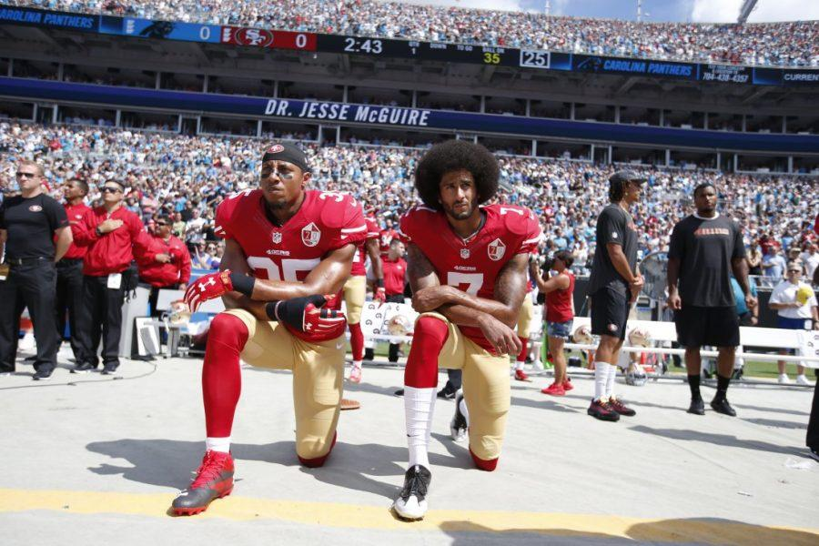 CHARLOTTE%2C+NC+-+SEPTEMBER+18%3A+Eric+Reid+%2335+and+Colin+Kaepernick+%237+of+the+San+Francisco+49ers+kneel+on+the+sideline%2C+during+the+anthem%2C+prior+to+the+game+against+the+Carolina+Panthers+at+Bank+of+America+Stadium+on+September+18%2C+2016+in+Charlotte%2C+North+Carolina.+The+Panthers+defeated+the+49ers+46-27.+%28Photo+by+Michael+Zagaris%2FSan+Francisco+49ers%2FGetty+Images%29