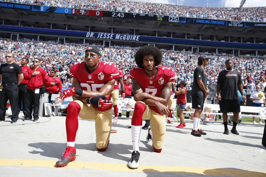 CHARLOTTE, NC - SEPTEMBER 18: Eric Reid #35 and Colin Kaepernick #7 of the San Francisco 49ers kneel on the sideline, during the anthem, prior to the game against the Carolina Panthers at Bank of America Stadium on September 18, 2016 in Charlotte, North Carolina. The Panthers defeated the 49ers 46-27. (Photo by Michael Zagaris/San Francisco 49ers/Getty Images)